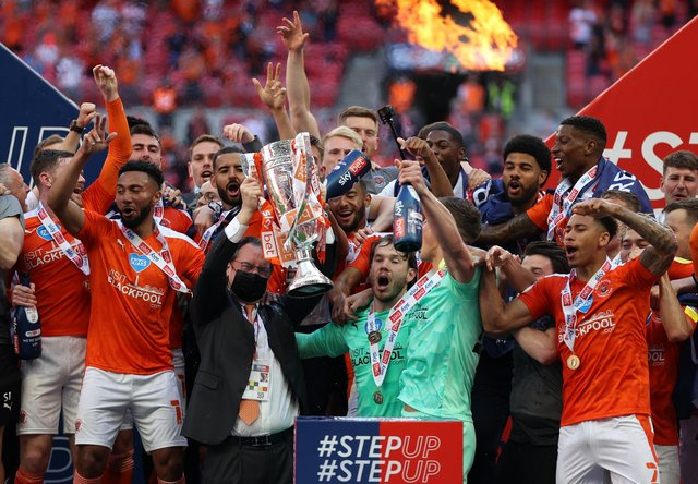 Former Sheffield Wednesday men Jordan Thorniley and Gary Madine were among the Blackpool players celebrating promotion to the Championship yesterday.