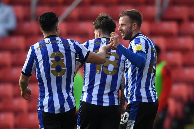 Jordan Rhodes of Sheffield Wednesday celebrates with Josh Windass and Joey Pelupessy.