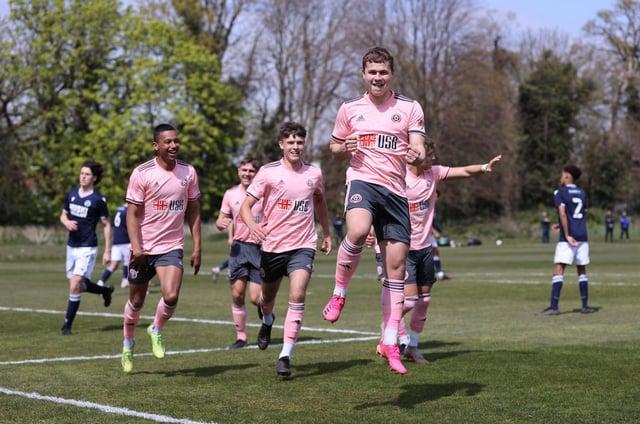 Zak Brunt celebrates after putting United's U23s ahead at Millwall: David Klein / Sportimage