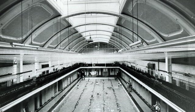 The roof of the mixed bathing pool with a net to catchthe falling bts of the unsafe roof on July 3, 1969