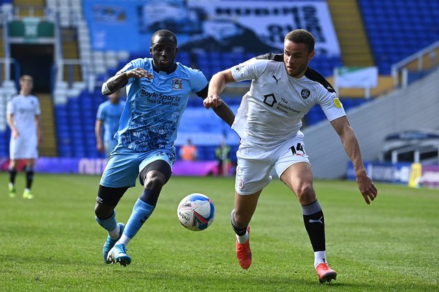 Julien Dacosta of Coventry City battles for possession with Carlton Morris of Barnsley.