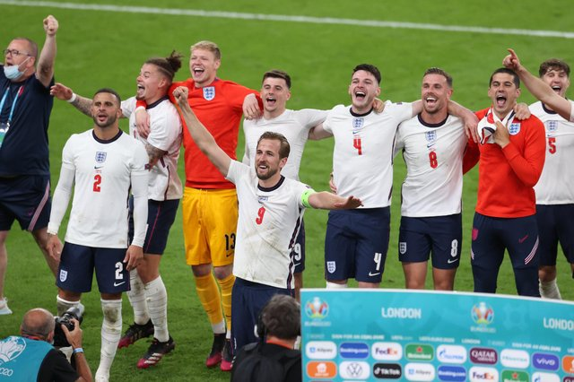 LONDON, ENGLAND - JULY 07: Kyle Walker, Kalvin Phillips, Aaron Ramsdale, Harry Kane, Mason Mount, Declan Rice, Jordan Henderson, Conor Coady and John Stones of England celebrate their side's victory towards the fans after the UEFA Euro 2020 Championship Semi-final match between England and Denmark at Wembley Stadium on July 07, 2021 in London, England: Catherine Ivill/Getty Images