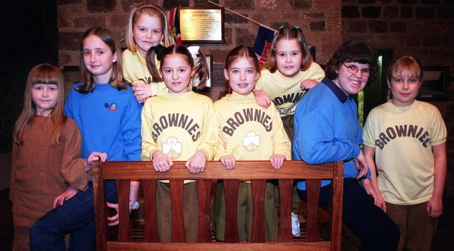 Whiston district Guides and Brownies joined forces to put on a gang show to celebrate the millennium at the Whiston Manorial Barn with over 200 girls taking part. Left to right for the camera are, Emily Richmond, 7, 11th brownies, Lucy Smith, 11, 51st guides, Amy Crawshaw, 8, 53rd brownies, Adelle Shaw, 9,31st brownies. Hollie Karle, 8, 62nd brownies, Lauren Keeling, 9, 51st brownies, Laura Southwell, 14, 11th guides and Rebecca Watson, 9, 50th brownies.