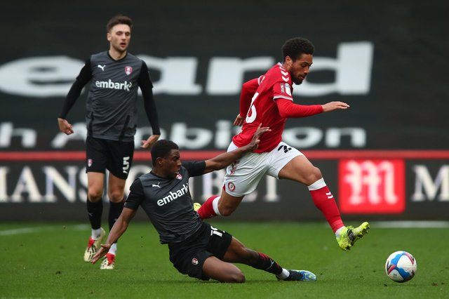 Zak Vyner of Bristol City in action with Lewis Wing and Wes Harding of Rotherham United.