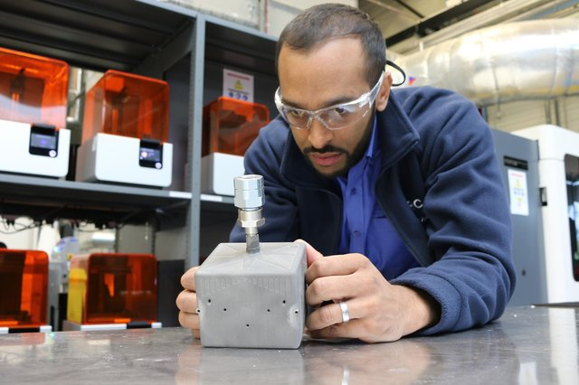 2020 - Abdul Haque, technical lead in metal additive manufacturing at the AMRC, inspects a lightweight fuel tank for small scale satelilites, designed and developed at the AMRC as part of the MiniTANKS project