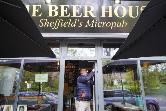 Co-owner Chris Sinclair makes repairs at The Beer House on Ecclesall Road which has been victim of a break-in. Picture Scott Merrylees