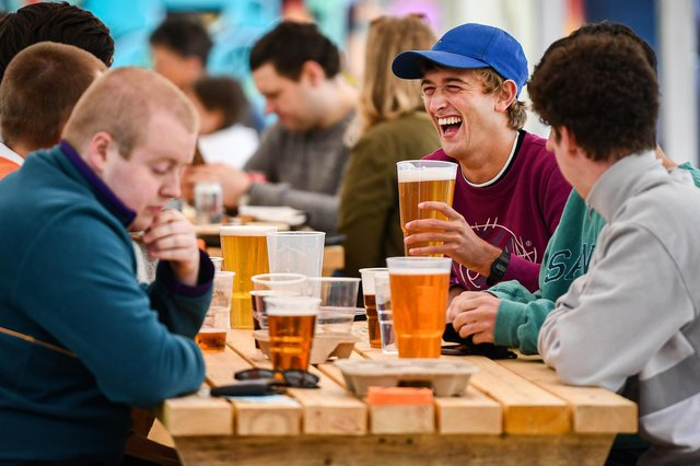 Members of the public enjoy their first drink in a beer garden (Photo by Jeff J Mitchell/Getty Images)