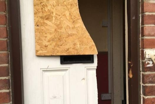 The door of the property was battered down by police.