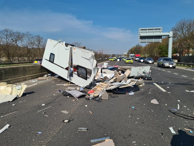 The aftermath of a crash on the M1 near Meadowhall involving an HGV and a caravan
