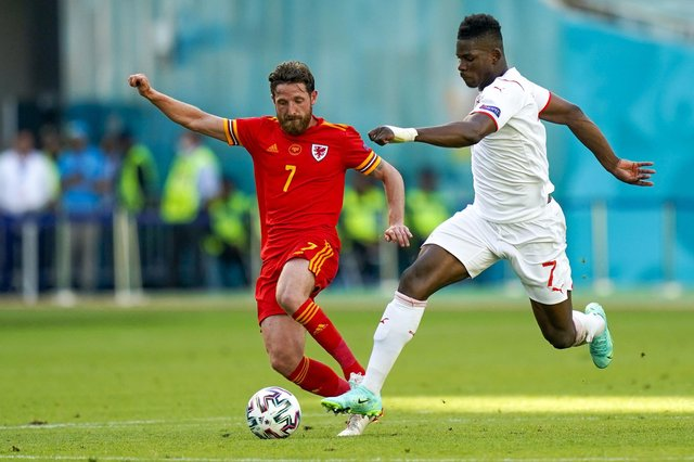 Wales' Joe Allen (left) and Switzerland's Breel Embolo battle for the ball during the UEFA Euro 2020 Group A match at the Baku Olympic Stadium, Azerbaijan. Picture date: Saturday June 12, 2021. PA Photo. See PA story SOCCER Wales. Photo credit should read: PA Wire.