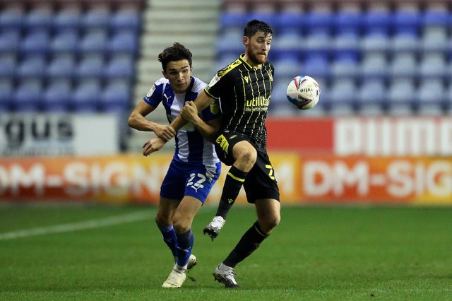 Jack Baldwin of Bristol Rovers battles for possession with Kyle Joseph of Wigan Athletic: Lewis Storey/Getty Images