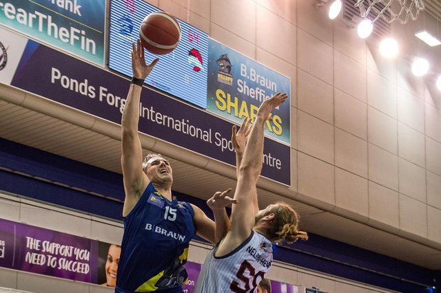 Mike Tuck scores against Leicester Riders in the British Basketball League.