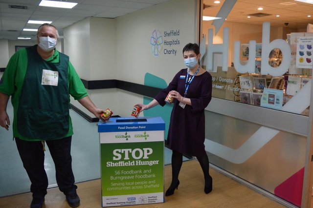 Chris Hardy and Kirsten Major make a donation