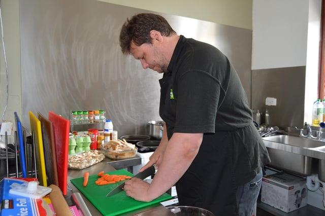 Adrian Colliver at work in the Emmaus Sheffield kitchen