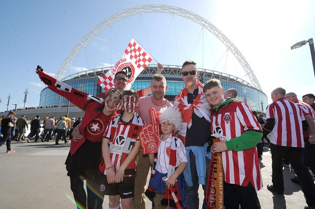 Sheffield United fans pose for a photo outside Wembley, before the FA Cup semi final against Hull City: Martin Rickett/PA Wire.