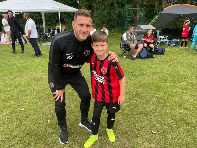 Billy Sharp with his eight-year-old son, Leo