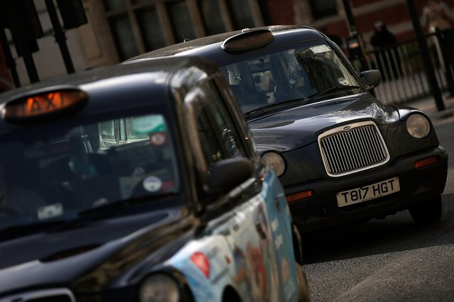 Cabs wait in London (Photo by Matthew Lloyd/Getty Images)
