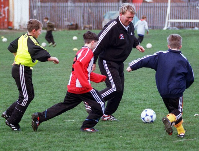Sheffield United legend Tony Currie takes on some of the youngsters at his soccer school held at Sheffield Works Ground during the April 1999 half term holidays