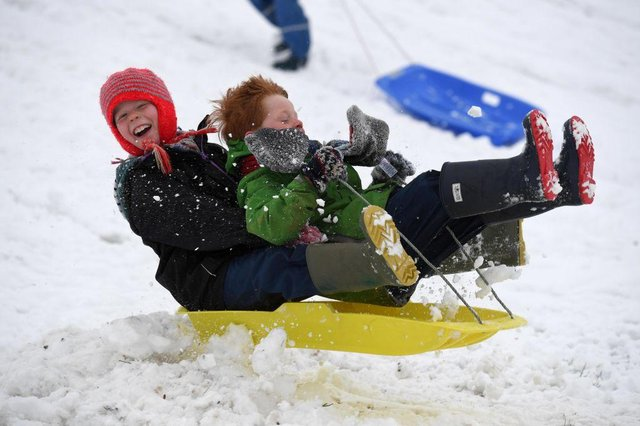 Children enjoy a day off school with some sledging (Photo by Finnbarr Webster/Getty Images)