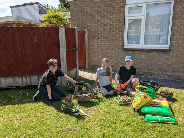 Volunteers Dan Johnson (left) and Will Jones (right) with Dan's sister Lucy in the garden of Housteads care home