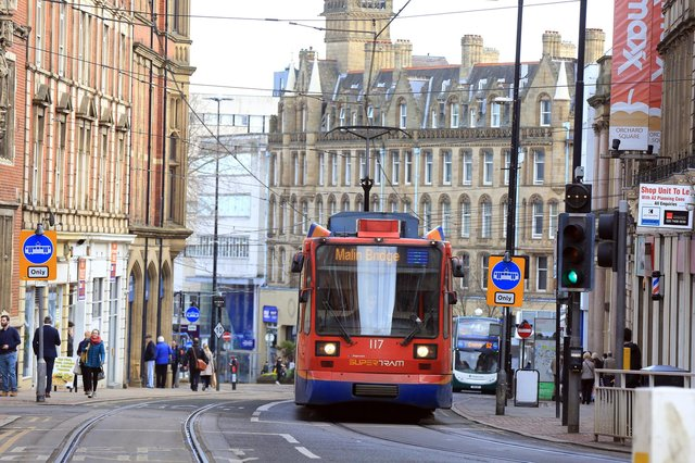 Sheffield Supertram heading up Church Street.