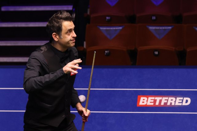 Ronnie O'Sullivan celebrates first-round victory on Saturday at The Crucible.