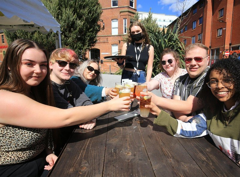 Friends celebrating the reopening of outdoor bar areas at The Forum, Sheffield