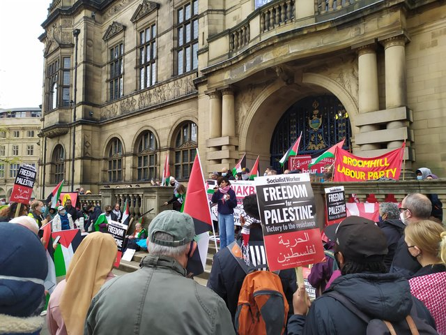 Protestors gathered outside Sheffield Town Hall on Saturday at noon.
