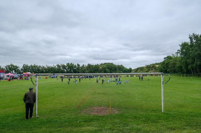 A man watches the action from the LJS Cup football tournament at Handsworth - Dean Atkins