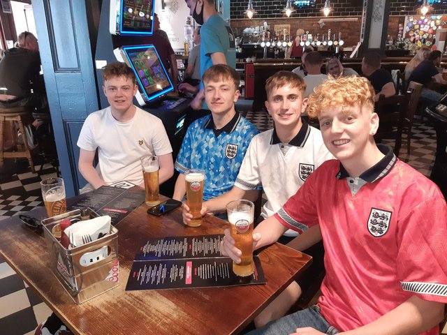 England fans at The Clubhouse pub in Sheffield. Pictured left to right are Ross Findleay, Sid Toovey, Leon Clark and Ethan Slater