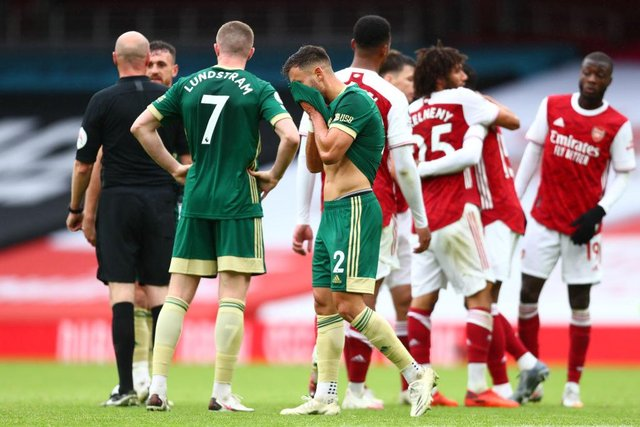 George Baldock of Sheffield United reacts after the defeat at Arsenal. Photo by Clive Rose/Getty Images