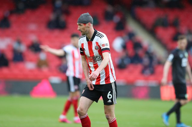 Chris Basham sported a headband against Burnley after taking a knock to the head: Simon Bellis / Sportimage