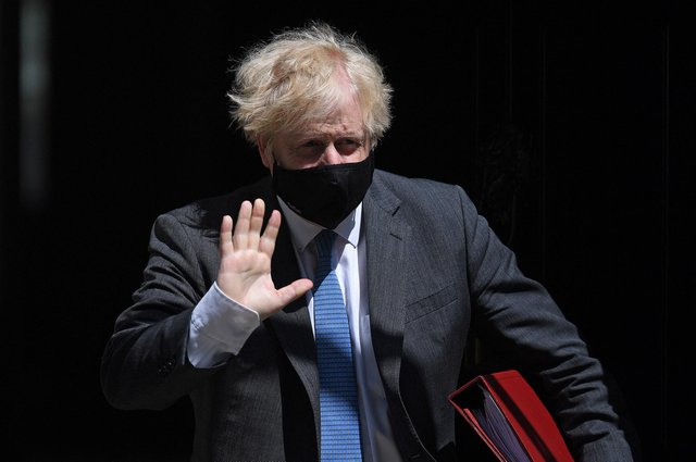 Prime Minister Boris Johnson wearing a face mask to combat the spread of Covid-19