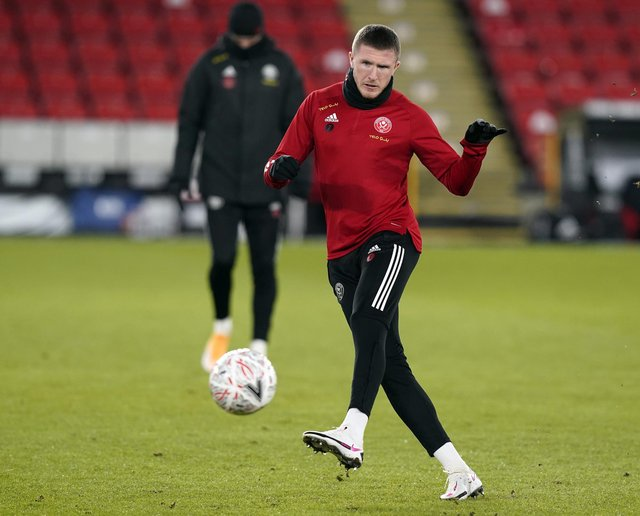 John Lundstram is expected to face Aston Villa at Bramall Lane: Andrew Yates/Sportimage