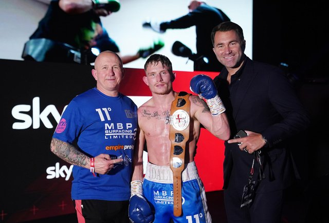 Dalton Smith, the new English super-lightweight champion, with his dad and trainer, Grant (left), and promoter Eddie Hearn.