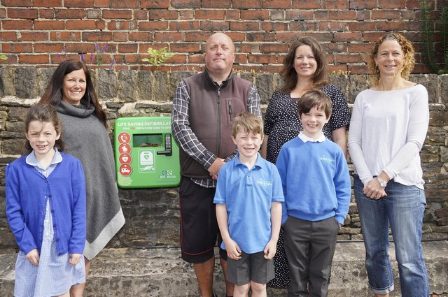 Ecclesall Parents Teachers Friends Association raised funds for two defibrillators at Ecclesall Primary School.  Back row, from left: Emma Hardy, Andrew Moffatt, Natalie Offord and Melanie Bancroft. Front row: Olivia and Felix Bancroft and Sam Offord. Picture Scott Merrylees