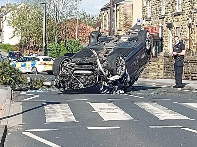 A car landed on its roof in a crash in Woodhouse, Sheffield, yesterday (Photo: JON MATTHEWS)