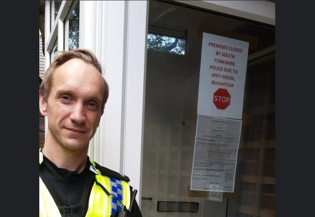 PC Darren Hibberd pictured issuing the papers to close the house in Parson Cross