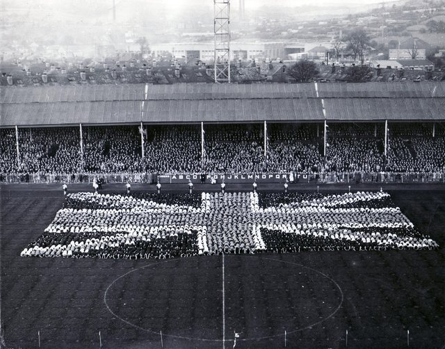 Queen Elizabeth II visit to Sheffield 27th October 1954 - Hillsborough Football GroundSheffield schoolchildren come to the climax of their tableau as they bow down before the Queen and form the Union Jack