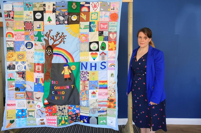 The community quilt was the culmination of a Year long effort by the residents of Crosspool to record and recognise the life we are living under the Covid pandemic. Pictured is Amy Chambers. Picture: Chris Etchells
