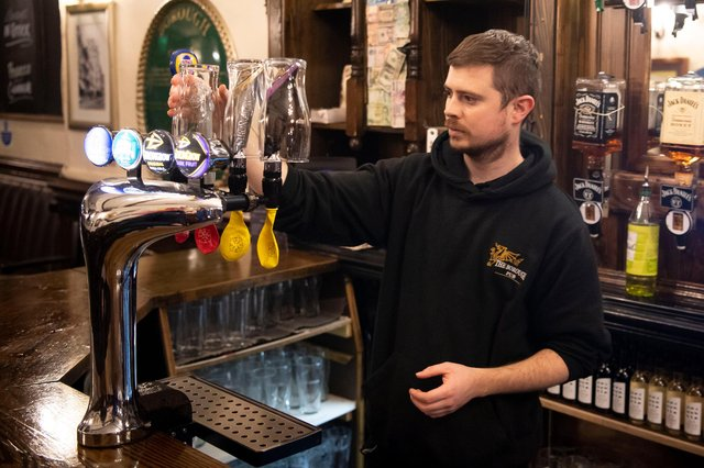 CARDIFF, WALES - DECEMBER 04: A worker covers up beer taps in the Borough pub on December 4, 2020 in Cardiff, Wales. Following a firebreak period that ran from October 23 to November 9 the Welsh Government have introduced new rules which will prevent pubs, restaurants and cafes from selling alcohol at any time from 6pm on Friday. The rules will be reviewed on December 17. (Photo by Matthew Horwood/Getty Images)