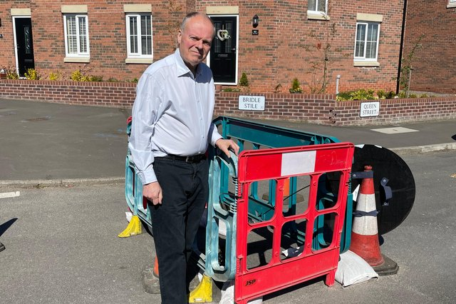 MP Clive Betts pictured next to the hole in Queen Street in Mosborough.