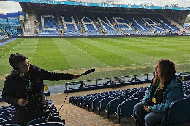 Star reporter Julia Armstrong being interviewed by film-maker Laura Page for a Stoppage Time film on the history of women's football