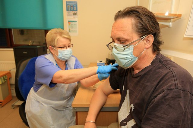 Belgrave Medical Centre reaches vaccine milestone. Pictured is Angus Hunter recieving his vaccine from Janice Wake. Picture: Chris Etchells