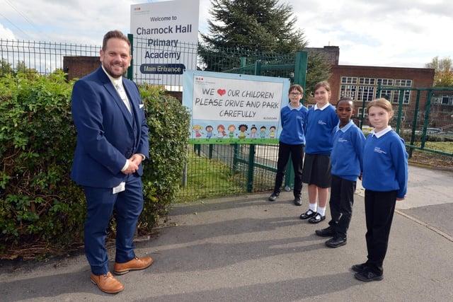 Charnock Hall Academy headteacher Paul Burgess with the head boys and girls.