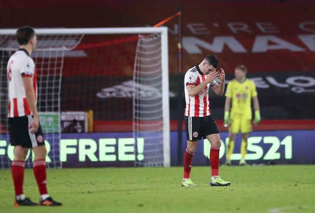 Sheffield United's John Egan reacts after Leicester's Jamie Vardy scored his side's winner (Nick Potts, Pool via AP)