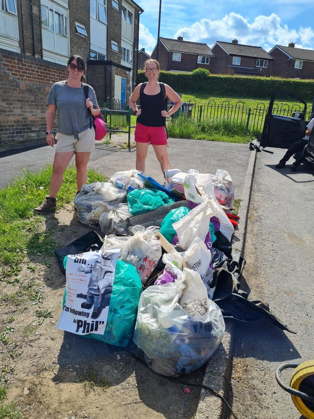 Litter pickers Rebecca Watts, left, and Sam Bough with some of the rubbish they cleared on their 10.5-hour training session