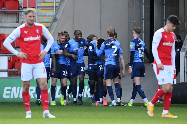 David Wheeler of Wycombe Wanderers (obscured) celebrates with teammates after scoring their team's third goal during the Sky Bet Championship match between Rotherham United and Wycombe Wanderers at AESSEAL New York Stadium. (Photo by Ross Kinnaird/Getty Images)