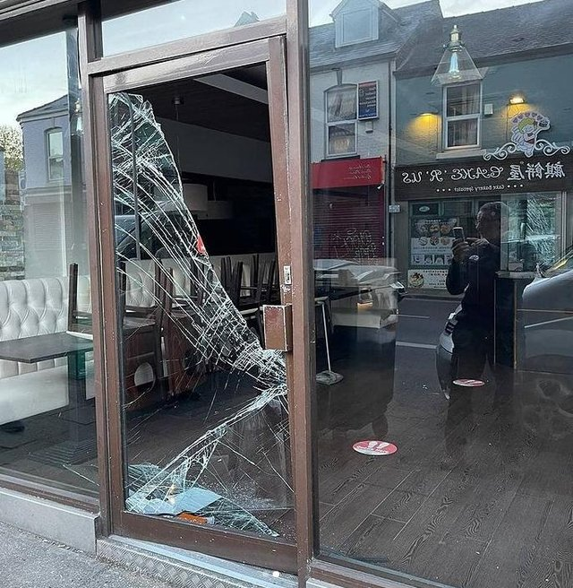 The door to La Crème on London Road, Sheffield, was smashed in overnight