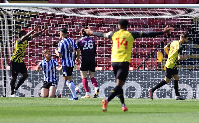 Tom Lees of Sheffield Wednesday reacts after scoring an own goal for Watford's first goal.